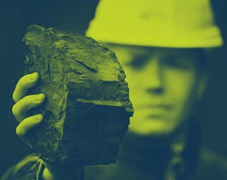 worker holding coal